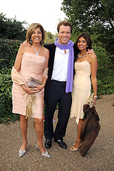 Left to right, VIMLA LALVANI, JOEL CADBURY and his wife DIVIA at the Royal Parks Foundation Summer Party hosted by Candy & Candy on the banks of the Serpentine, Hyde Park, London on 10th September 2008.
