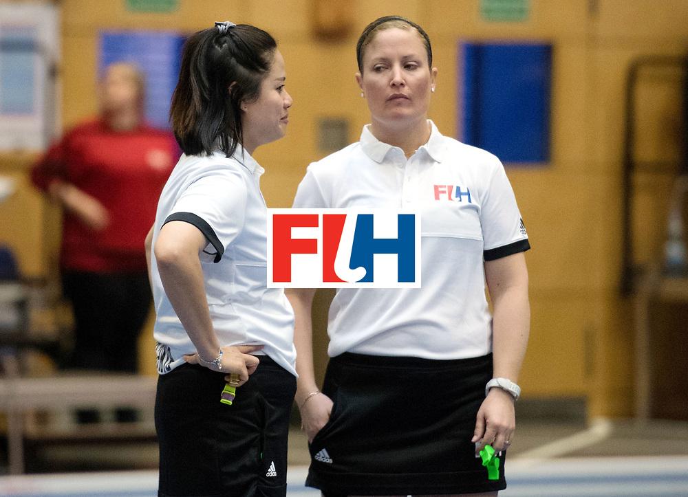 BERLIN - Indoor Hockey World Cup<br /> Belarus - Poland<br /> foto: umpires KITTITEERASOPON Ornpimol and Maddie Giddens<br /> WORLDSPORTPICS COPYRIGHT FRANK UIJLENBROEK