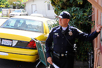 Salinas police officer Richard Lopez goes door-to-door along Fremont Street to introduce residents to the CASP program. The Community Alliance for Safety and Peace is an ambitious program that aims to steer youth away from gang violence and toward solutions offered by more than 30 local organizations offering alternatives.