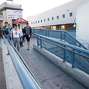 "Artist Ana Teresa Fernández with local and some Arizonians walks to cross U.S. border to paint the fence in blue color the theme called ""Erasing the Border"" in Nogales Sonora, Mexico on October 13, 2015."