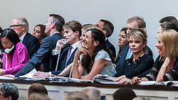 © Licensed to London News Pictures. 24/06/2015. London, UK. Sotheby's staff bidding on behalf of their telephone clients enjoy light hearted respite from the seriousness of the bidding process. Sotheby's Impressionist & Modern art evening sale realised a total of £178.6m, the second highest total for any sale ever held in London.  Photo credit : Stephen Chung/LNP