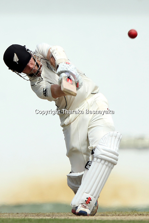 New Zealand cricketer Kane Williamson plays a shot during the first day of the second and final Test match between Sri Lanka and New Zealand at the P. Sara Oval Cricket Stadium in Colombo on November 25, 2012. New Zealand captain Ross Taylor won the toss and elected to bat.