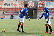 Rangers midfielder Andrew Halliday (16) and Rangers midfielder Steven Davis (10) discuss a free kick during the Ladbrokes Scottish Premiership match between Hamilton Academical FC and Rangers at New Douglas Park, Hamilton, Scotland on 24 February 2019.