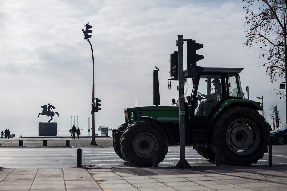 A farmer in his tractor during a march inside the city of Thessaloniki, Greece, on the 2nd of February 2017. Farmers from around northern Greece gathered in Thessaloniki during the opening of the Zootechnia international livestock to demonstrate against the austerity measures put by the Greek government.