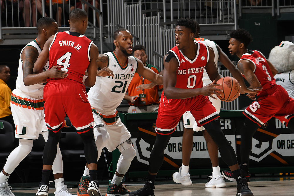 December 31, 2016: Abdul-Malik Abu #0 of North Carolina State in action during the NCAA basketball game between the Miami Hurricanes and the North Carolina State Wolfpack in Coral Gables, Florida. The 'Canes defeated the Wolfpack 81-63.