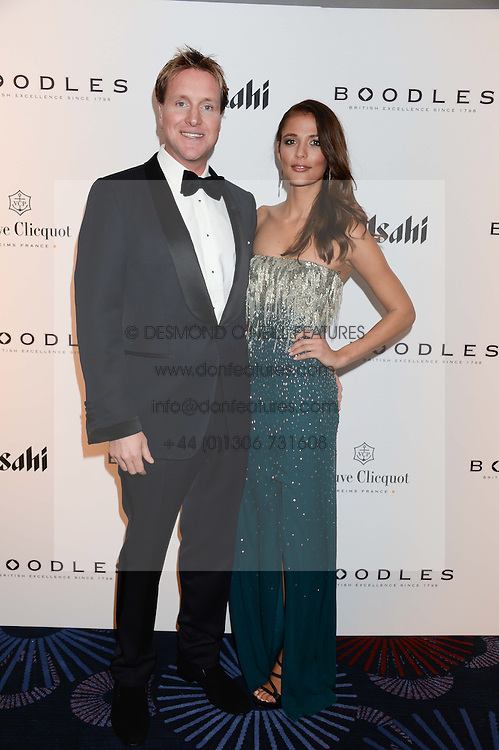 British fine jewellery brand Boodles welcomed guests for the 2013 Boodles Boxing Ball in aid of Starlight Children's Foundation held at the Grosvenor House Hotel, Park Lane, London on 21st September 2013.<br /> Picture Shows:-HENRY BECKWITH and JO RENWICK<br /> <br /> Press release - https://www.dropbox.com/s/a3pygc5img14bxk/BBB_2013_press_release.pdf<br /> <br /> For Quotes  on the event call James Amos on 07747 615 003 or email jamesamos@boodles.com. For all other press enquiries please contact luciaroberts@boodles.com (0788 038 3003)