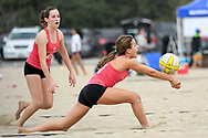 A player from Sports Academy bumps the ball as her teammate watches at Santa Monica Beach in Santa Monica, Calif. on Nov. 12, 2017.
