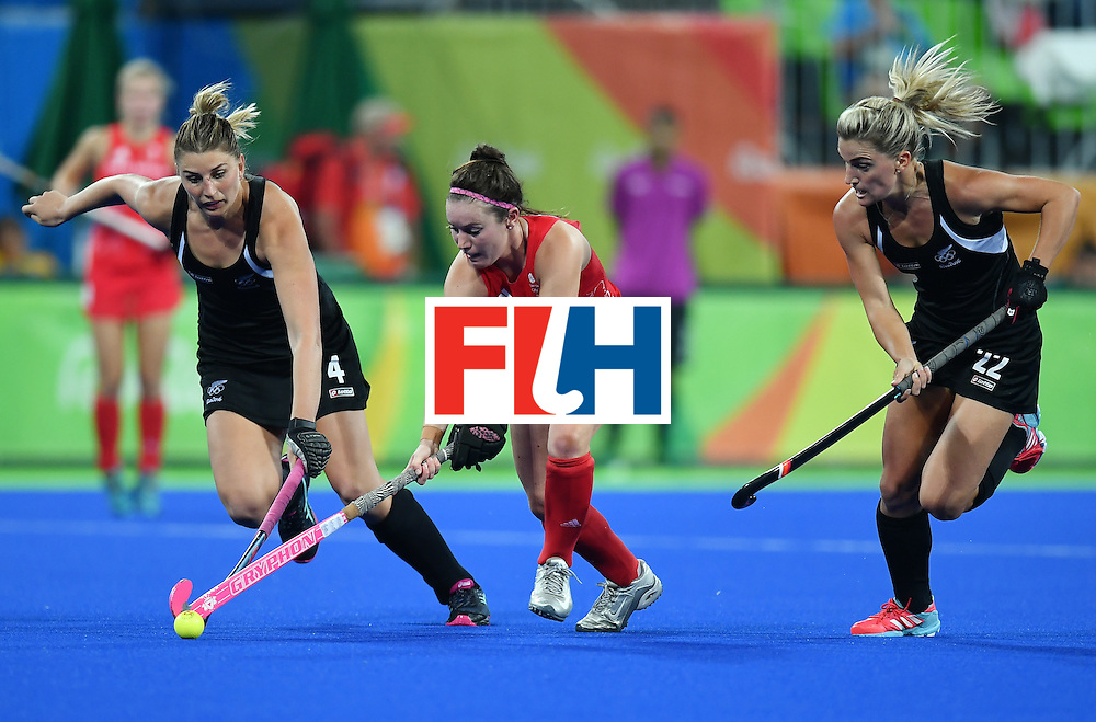 New Zealand's Olivia Merry (L) and New Zealand's Gemma Flynn (R) vie with Britain's Laura Unsworth during the women's semifinal field hockey New Zealand vs Britain match of the Rio 2016 Olympics Games at the Olympic Hockey Centre in Rio de Janeiro on August 17, 2016. / AFP / MANAN VATSYAYANA        (Photo credit should read MANAN VATSYAYANA/AFP/Getty Images)