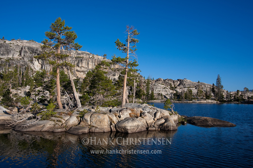 Slabs of granite jut out into Boundary Lake, Yosemite National Park