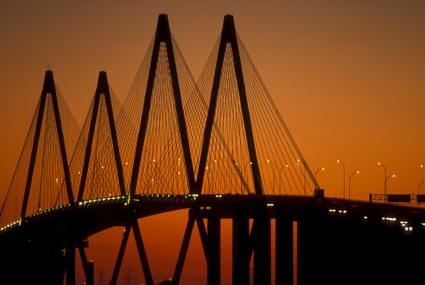 Silhouette of the Fred Hartman Bridge in Galveston Texas at sunset