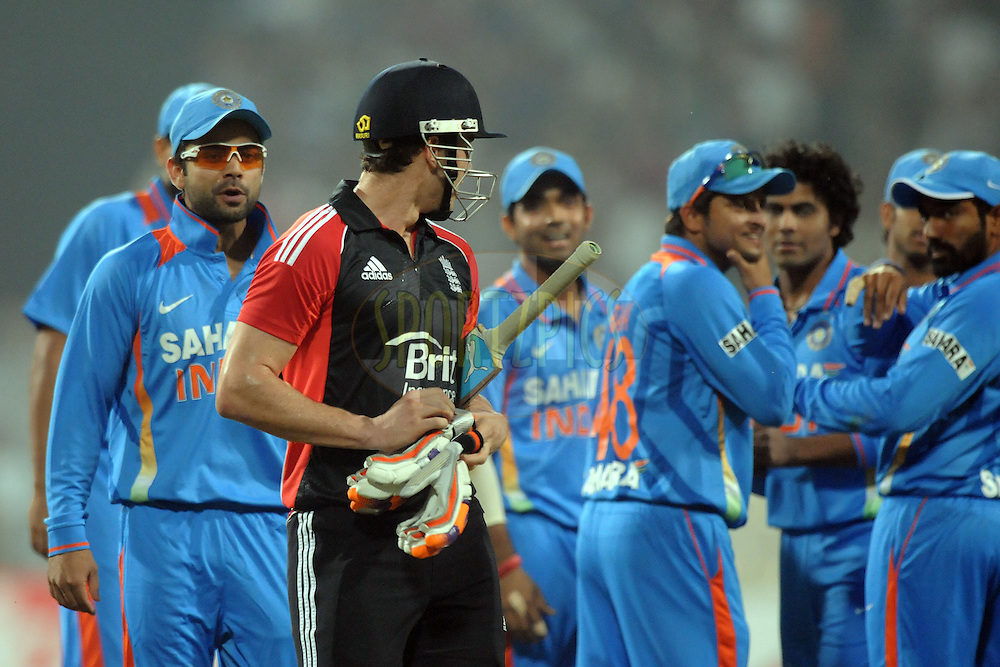 Virat Kohli of India exchange few words with Craig Kieswetter of England during the T20 International match between India and England held at the Eden Gardens Stadium, Kolkata on the 29th October 2011..Photo by Pal Pillai/BCCI/SPORTZPICS