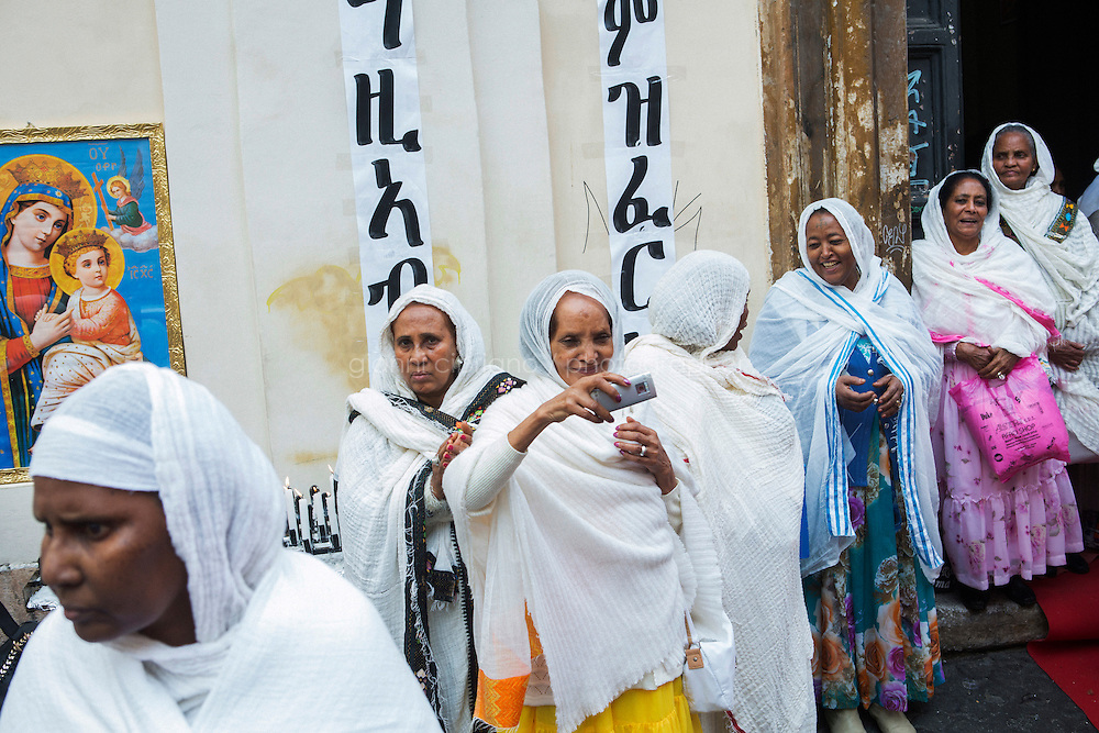 ROME, ITALY - 23 NOVEMBER 2014: Eritrean refugees of the Orthodox Tewahedo Church celebrate the fest of St-Michael to celebrate in Rome, Italy, on November 23th 2014.