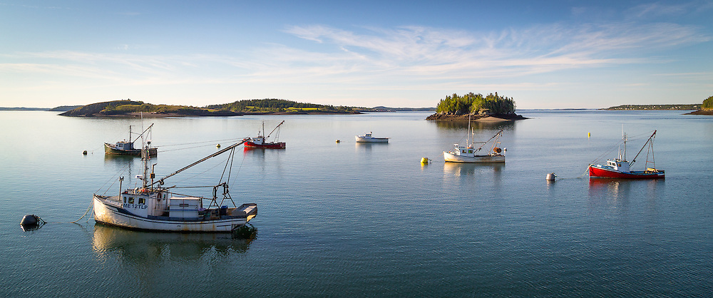 A beautiful day on the Downeast coast with an assortment of fishing boats set against the islands in the bay.