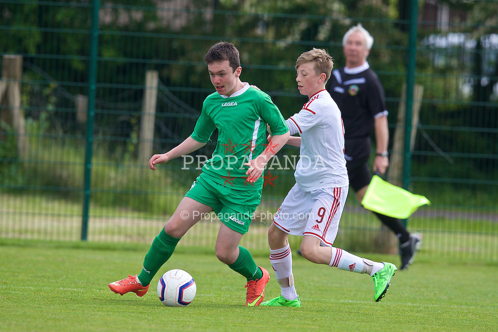 NEWPORT, WALES - Thursday, May 28, 2015: Regional Development Boys' Ryan Gibbons and Central WPL Academy Boys' Osian Jones (Porth) during the Welsh Football Trust Cymru Cup 2015 at Dragon Park. (Pic by David Rawcliffe/Propaganda)