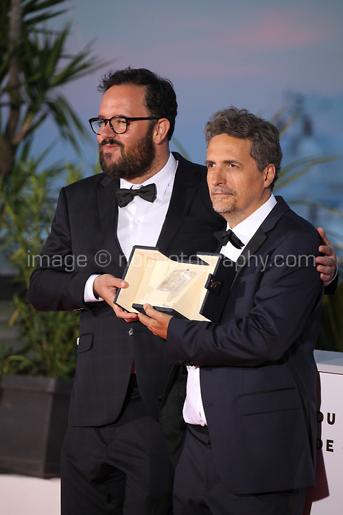 Juliano Dornelles and Kleber Mendonça Filho, winners of the Jury Prize for the film Bacurau at the Palme D'Or Award photo call at the 72nd Cannes Film Festival, Saturday 25th May 2019, Cannes, France. Photo credit: Doreen Kennedy