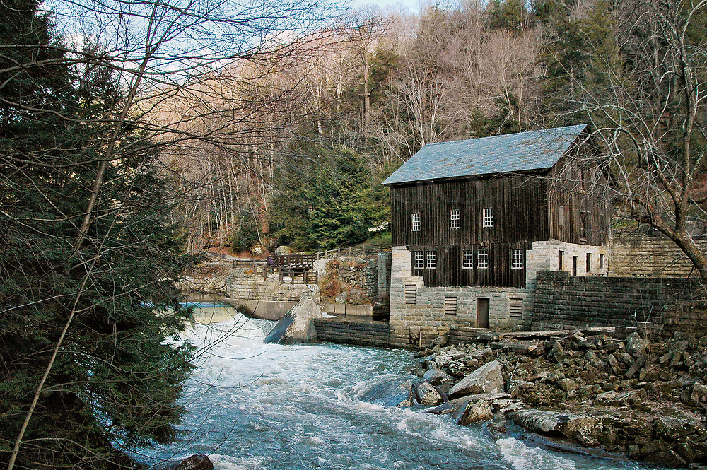 McConnell's Mill sits along a whitewater river in very early Spring in scenic Pennsylvania, and it also a state park with extensive hiking trails and kayaking on Slippery Rock Creek. The mill dates from the 1800's and there is also a covered bridge here of the same vintage.