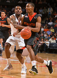 Miami (FL) guard Lance Hurdle (1) is fouled by Virginia guard Jeff Jones (23).  The Virginia Cavaliers fell to the Miami Hurricanes 62-55 at the John Paul Jones Arena on the Grounds of the University of Virginia in Charlottesville, VA on February 26, 2009.