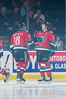 KELOWNA, CANADA - NOVEMBER 25: Carsen Twarynski #18 and Gordie Ballhorn #4 of the Kelowna Rockets take part in a pre-game ritual against the Medicine Hat Tigers on November 25, 2017 at Prospera Place in Kelowna, British Columbia, Canada.  (Photo by Marissa Baecker/Shoot the Breeze)  *** Local Caption ***