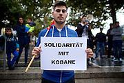 Frankfurt am Main | 08 Oct 2014<br /> <br /> Am Mittwoch (08.10.2014) nahmen an der Konstablerwache in der Innenstadt von Frankfurt am Main etwa 100 Menschen an einer Kundgebung f&uuml;r Solidarit&auml;t mit der von IS (ISIS, ISIL, Islamischer Staat) angegriffenen Stadt Kobane (auch: Ain al-Arab) teil. Die kundgebung verlief friedlich, es kam nur zu einer kleinen St&ouml;rung durch einen jungen Moslem, der sich durch einen Redebeitrag in seinem Glauben beleidigt f&uuml;hlte.<br /> Hier: Ein junger Mann mit einem Transparent mit der Aufschrift &quot;Solidarit&auml;t mit Kobane&quot;.<br /> <br /> &copy;peter-juelich.com<br /> <br /> [No Model Release | No Property Release]