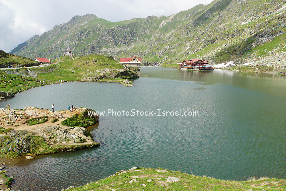 Balea Lac Chalet over Balea glacier Lake next to Transfagarasan Road in Fagaras Mountains, Romania