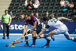 Wimbledon's Phil Ball is tackled by Nick Parkes and Luke Noblett of Surbiton. Wimbledon v Surbiton - Men's Hockey League Final, Lee Valley Hockey & Tennis Centre, London, UK on 23 April 2017. Photo: Simon Parker