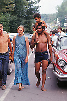 People on the road to the Woodstock Music Festival