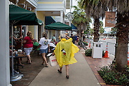 A woman wards off rain showers with a Mickey Mouse poncho before a campaign rally with Republican Vice Presidential candidate  Rep. Paul Ryan (R-WI) on Saturday, August 18, 2012 in The Villages, FL.