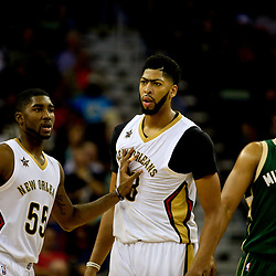 Nov 1, 2016; New Orleans, LA, USA; New Orleans Pelicans guard E'Twaun Moore (55) holds back forward Anthony Davis (23) after a technical foul call during the second quarter of a game against the Milwaukee Bucks at the Smoothie King Center. Mandatory Credit: Derick E. Hingle-USA TODAY Sports