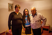 Proud parents Ivana and Gheorghe Budrega with their daughter Cornelia - a 22 years old Roma student in the house of her parents. She is is studying Commercial Business Administration in a Master Degree Program in Bucharest and never experienced any kind of discrimination because of being a Roma.