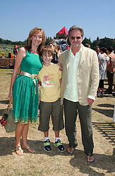 Actor TREVOR EVE, his wife actress SHARON MAUGHAN and their son at the Veuve Clicquot sponsored Gold Cup Final or the British Open Polo Championship held at Cowdray Park, West Sussex on 17th July 2005.<br /><br />NON EXCLUSIVE - WORLD RIGHTS