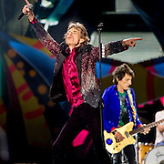 HAVANA, CUBA - MARCH 25, 2016: Mick Jagger, Ron Wood, and Charlie Watts perform with The Rolling Stones at Ciudad Deportiva on March 25, 2016 in Havana, Cuba. The Rolling Stones performance is the first by a major international rock band in Cuba, coming days after a historic visit by President Barack Obama of the United States, and a game between the Tampa Bay Rays and the Cuban National Team at Estadio Latinoamericano. The Cuban government banned rock music on Cuban state TV and radio following the Cuban the revolution, and nearly a half-million people are in attendance to be part of the historic event. (Photo by Jean Fruth)