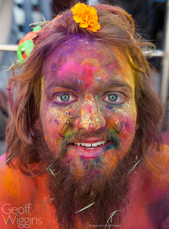 Young man covered in paint and dye for the Indian Holi Festival. Pushkar Rajasthan, India