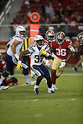 Los Angeles Chargers running back Justin Jackson (32) and San Francisco 49ers defensive back Antone Exum (38) in action during the 2018 NFL preseason week 4 football game against the San Francisco 49ers on Thursday, Aug. 30, 2018 in Santa Clara, Calif. The Chargers won the game 23-21. (©Paul Anthony Spinelli)