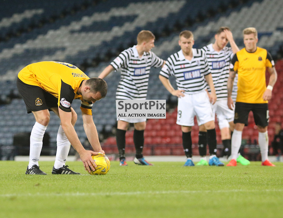 Garry Fleming lines up the pen during the Queens Park FC V Dumbarton FC Petrofac Training Cup 18th August 201(c) Andy Scott | SportPix.org.uk