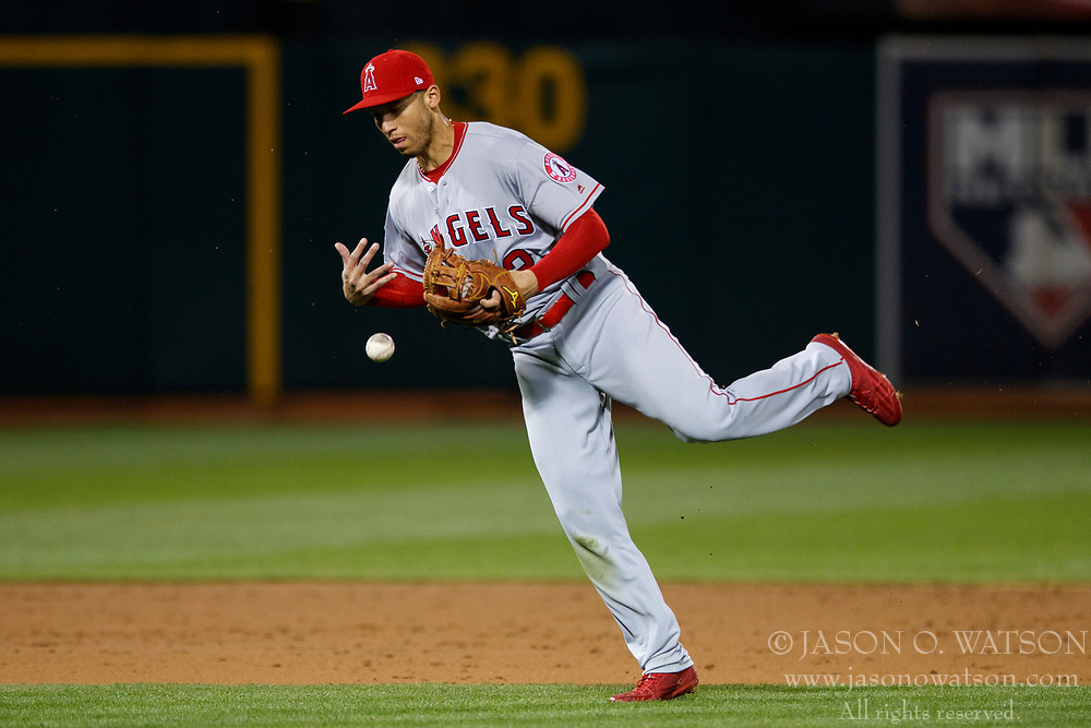 OAKLAND, CA - APRIL 04:  Andrelton Simmons #2 of the Los Angeles Angels of Anaheim is unable to field a ground ball hit for an infield single off the bat of Rajai Davis (not pictured) of the Oakland Athletics during the third inning at the Oakland Coliseum on April 4, 2017 in Oakland, California. The Los Angeles Angels of Anaheim defeated the Oakland Athletics 7-6. (Photo by Jason O. Watson/Getty Images) *** Local Caption *** Andrelton Simmons