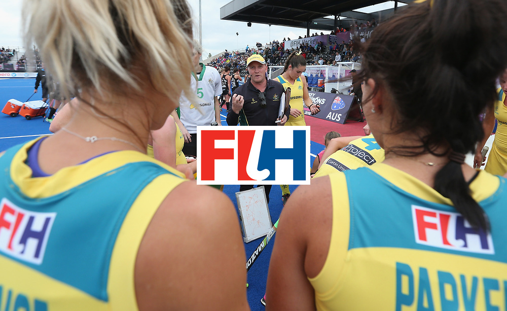LONDON, ENGLAND - JUNE 19:  Australia coach Adam Commens talks to his players at third break during the FIH Women's Hockey Champions Trophy match between Australia and New Zealand at Queen Elizabeth Olympic Park on June 19, 2016 in London, England.  (Photo by Alex Morton/Getty Images)