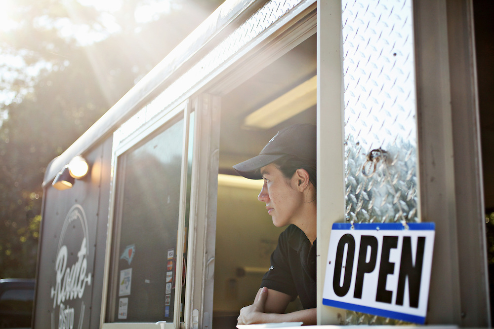 Ana Perez watches for customers as the Route Bistro food truck opens for business on Friday evening, July 29, 2016. The truck was named the 2015 Food Truck Rookie of the Year by Mobile Cuisine magazine.