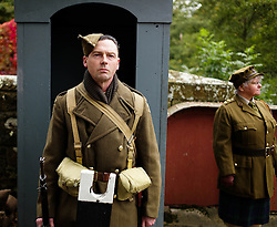 © Licensed to London News Pictures. <br /> 16/10/2016. <br /> Goathland, UK.  <br /> <br /> A member of the Home Guard stands on sentry duty at Goathland station during the final day of the North Yorkshire Moors Railway Wartime Weekend event. <br /> The annual event brings together re-enactors and enthusiasts along the length of the NYMR heritage steam railway line to recreate the feel of the war years of the 1940's. <br /> <br /> Photo credit: Ian Forsyth/LNP