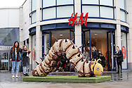 A giant 10ft long caterpillar made out of Nestl&eacute; whole grain breakfast Cereals is seen in Churchill Square Shopping Centre in Brighton. The massive creepy crawlie is made from Shreddies and Nesquik.<br /> <br /> Please credit BRIGHTON TOGS