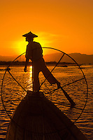 Legrowing fisherman on Inle Lake at sunset, Inle Lake, Shan State, Myanmar (Burma)