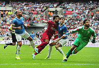 Football - 2019 FA Community Shield - Liverpool vs. Manchester City<br /> <br /> Mohamed Salah of Liverpool sees his header cleared of the line as Goalkeeper, Claudio Bravo and Nicolas Otamendi can only watch, at Wembley Stadium.<br /> <br /> COLORSPORT/ANDREW COWIE
