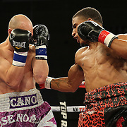 TAMPA, FL - FEBRUARY 28:  Clarence Booth (R) punches Osenohad Vazquez during the SoloBoxeo Tecate boxing match at the University of South Florida Sundome on February 28, 2015 in Tampa, Florida. Booth won the bout by knockout.  (Photo by Alex Menendez/Getty Images) *** Local Caption *** Clarence Booth; Osenohad Vazquez