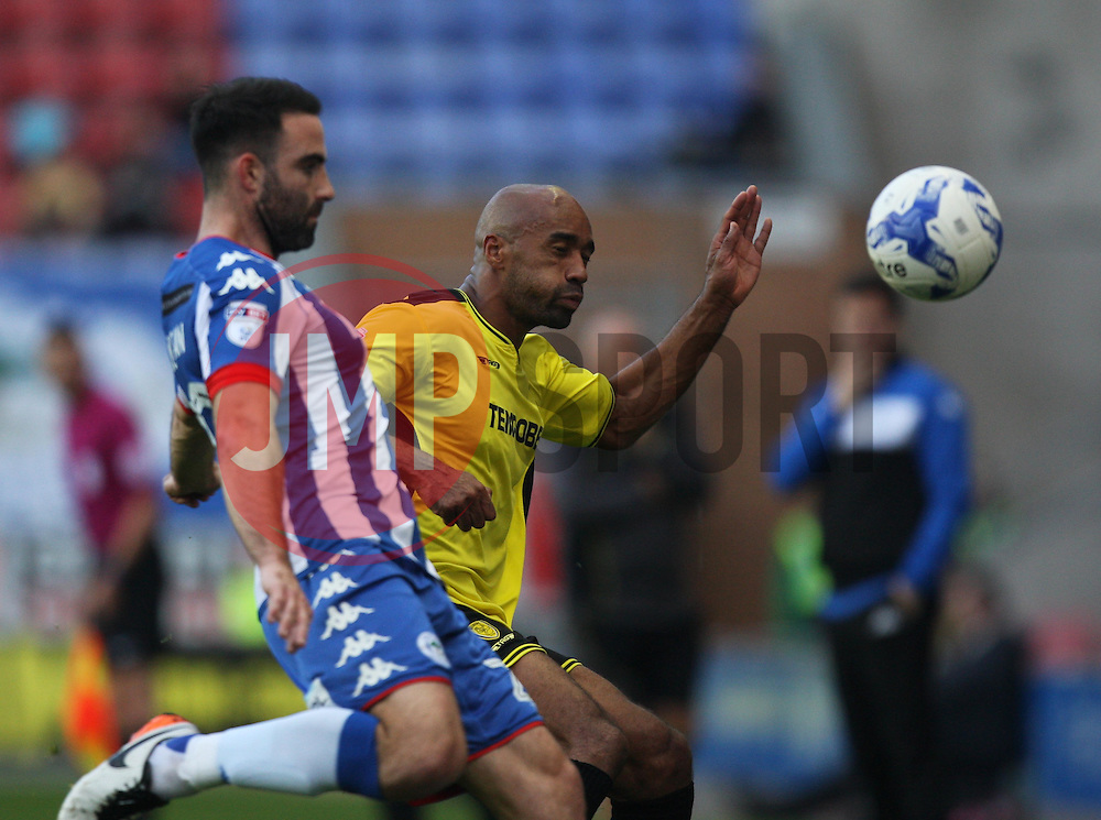 Craig Morgan of Wigan Athletic (L) and Chris O'Grady of Burton Albion in action - Mandatory by-line: Jack Phillips/JMP - 15/10/2016 - FOOTBALL - DW Stadium - Wigan, England - Wigan Athletic v Burton Albion - EFL Championship