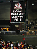 Sep. 24 2011; Phoenix, AZ, USA; A National League West Champions banner is unveiled at Chase Field prior to the first inning game of the Arizona Diamondbacks hosting the San Francisco Giants. Mandatory Credit: Jennifer Stewart-US PRESSWIRE