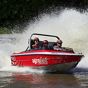 Visitors to AgroVentures experience the Agrojet, a jet boat sprint experience at AgroVentures Adventure Park,  Paradise valley road, Rotorua. .Agroventures  attractions include has the world's only Shweeb, a pedal powered mono rail, Agrojet, a jet boat sprint experience, Swoop  swing from 40m towards the earth at 130kmph and the Southern Hemispheres' only Freefall Xtreme, wind tunnel. Rotorua, New Zealand,, 10th December 2010. Photo Tim Clayton