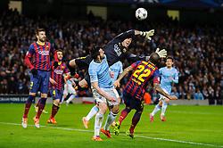 Barcelona Goalkeeper Victor Valdes (ESP) dives to block the ball from Man City Forward Alvaro Negredo (ESP) - Photo mandatory by-line: Rogan Thomson/JMP - Tel: 07966 386802 - 18/02/2014 - SPORT - FOOTBALL - Etihad Stadium, Manchester - Manchester City v Barcelona - UEFA Champions League, Round of 16, First leg.