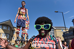 © Licensed to London News Pictures. 27/08/2017. London, UK. Performers take part in the Children's Parade during Family Day at the Notting Hill Carnival.  Over one million revellers are expected to attend Europe's biggest street party which takes place over the Bank Holiday Weekend. Photo credit : Stephen Chung/LNP