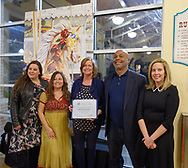 Garden City, New York, USA. March 9, 2019. L-R. SUSAN COOLS (BCA Corresponding Secretary), RITA CAVANAGH (BCA Beautification Committee Chair), New York State Assemblywoman JUDY GRIFFIN (District 21), Baldwin Civic Association President DARIEN WARD, and Hempstead Town Supervisor LAURA GILLEN pose next to mural by artist Michael White during Unveiling Ceremony. Event was held at historic Nunley's Carousel in its Pavilion on Museum Row on Long Island.
