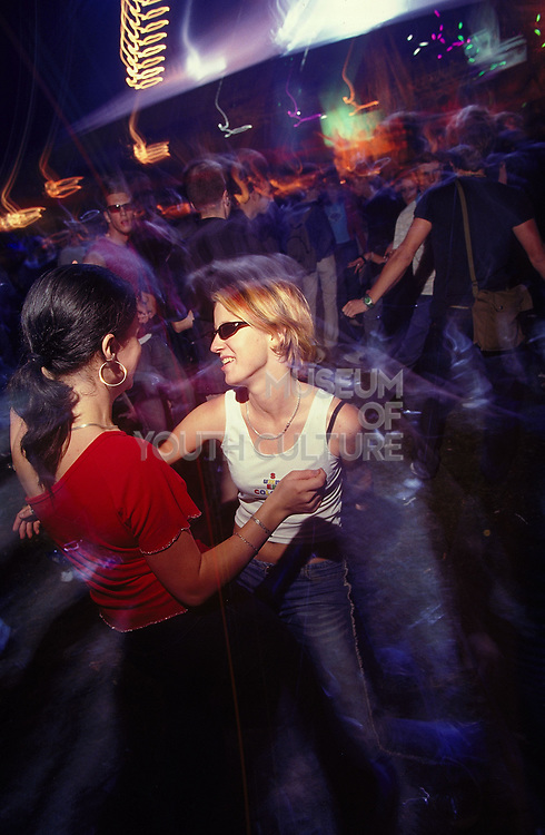 Two girls dancing at a dance music event Slovakia Bratislava July 2002
