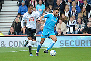 Wolverhampton Wanderers defender Scott Golbourne and Derby County midfielder Thomas Ince battle for the ball during the Sky Bet Championship match between Derby County and Wolverhampton Wanderers at the iPro Stadium, Derby, England on 18 October 2015. Photo by Alan Franklin.